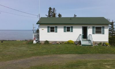 Photo for Fundy Escape Cottage - modern oasis with huge private shoreline & beach