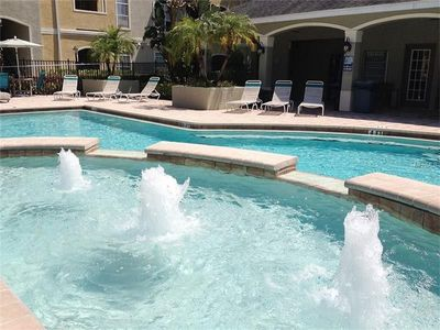 Fantastic Pool With Water Fountain & Palms