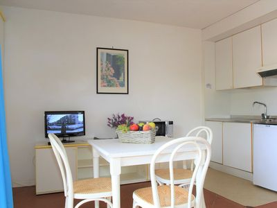 Photo for Bright Holiday Apartment with Wi-Fi and Pool, Close to the Beach