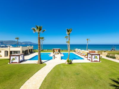 Photo for Fully staffed Beachfront residence on a sandy beach with 150 sqm private pool