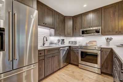 Fully equipped gourmet kitchen with modern stainless steel appliances