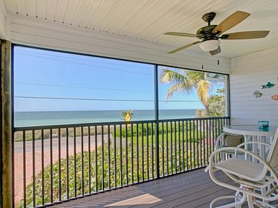 Photo for Listen to the sounds of the waves from your screened in porch- Gulf Front Townhome