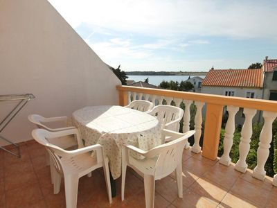 Photo for Two bedroom apartment with terrace and sea view Novalja (Pag) (A-9339-b)
