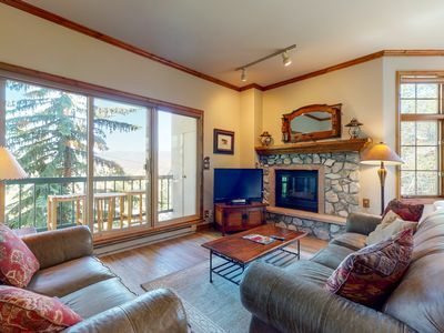 Photo for Delightful ski-in/ski-out condo w/ gas fireplace and shared pool & hot tubs!