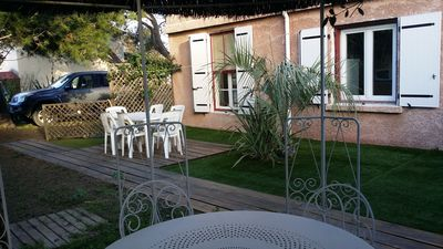 Photo for Ground floor apartment with garden in villa at 50 m from the beach