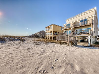 Photo for Beachfront getaway w/private beach access and close to shops, dining, and more!