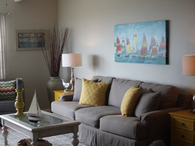 Photo for Beautiful Ocean Front Condo - steps to Ocean & a mile walk up the beach to town