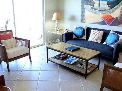 Photo for Bask in stunning ocean views in this 3 bedroom condo on Seven Mile Beach