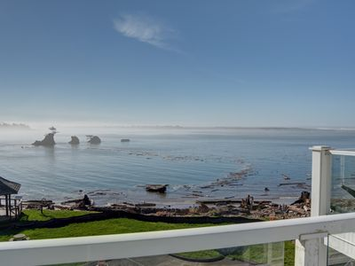 Photo for Experience this top floor condo located right on Siletz Bay in Lincoln City!
