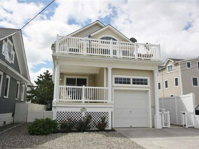 Photo for Bay views, POOL!!!  Walk to town to enjoy shopping, dining and recreation activities.