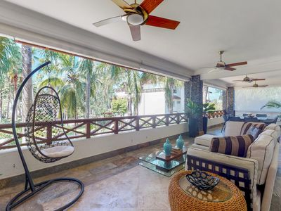 Photo for Spacious apartment at beachfront property w/ terrace, 2 shared pools & gym!