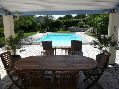 Photo for Near the harbor and beaches, beautiful provencal villa with pool