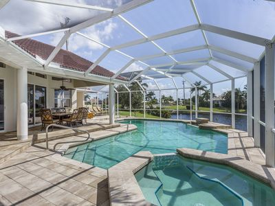 Photo for NEW LISTING! Stunning waterfront home on a canal w/ a dock and private  pool!