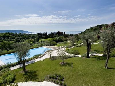 Photo for ELEGANT A NEWLY RENOVATED GOLF CLUB VILLA. POOL + LAKE VIEW