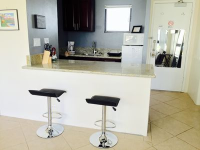 Kitchen and breakfast bar! We have pots, pans dishes, crock pot, rice cooker etc