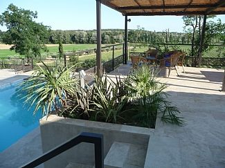 Terrace overlooking swimming pool and countryside