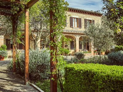 Photo for Villa with hot tub and garden embraced by the walls and ancient medieval towers