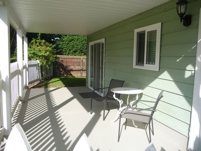 Suite has private covered patio with fenced yard on the west side.