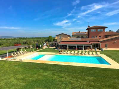 Photo for Attractive apartment for eight people on holiday with grass garden and swimming pool