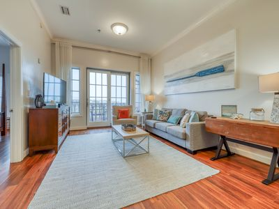 Photo for Top floor condo steps to the beach! Shared pool & close to shopping & dining!