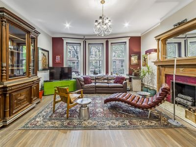 Photo for 1880's impeccably restored brownstone-triplex with garden, terrace