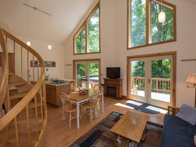 Photo for Pet friendly, fireplace, private hot tub, large deck, in quiet neighborhood