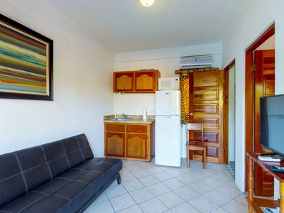 Affordable suite with shared grill view from rooftop & nearby beach access!