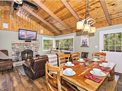 Photo for hot tub + pet friendly+ 2 bbqs+ decks with tree views+ cable+ master suite!