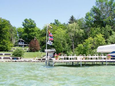 Photo for Beautiful Torch Lake Sunset Views ~ Tennis Court ~ Includes Kayaks ~ Playset!