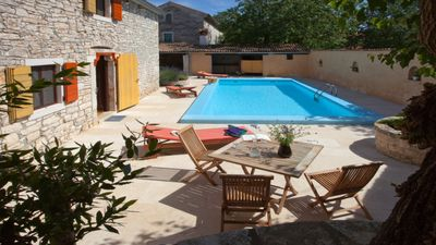 Photo for Charming traditional stone house with large pool and walled courtyard.