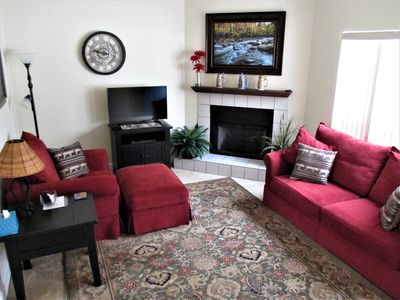 Living Room with Electric Log Fireplace & 39-inch Smart TV
