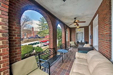 The stylish abode is set in a charming brick building with a furnished patio.