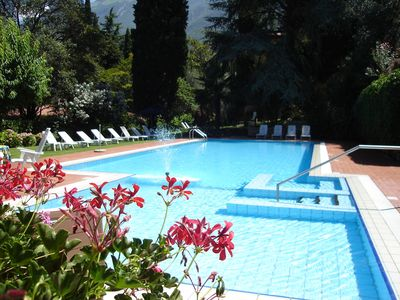 Photo for Residenza Villa Sopri - right on the lake, with nice garden and pool