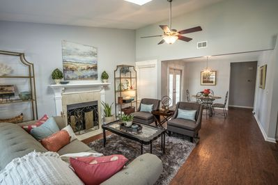 The open, decorative, family room that greets you upon entering the front door