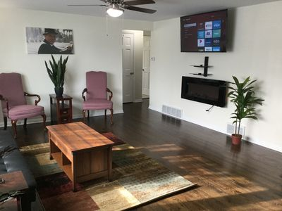 Enjoy watching TV in this cozy newly furnished living room.
