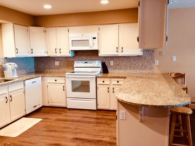 Photo for Lux Mountain Condo! Upscale Reno! Backs To River! All New! Great rate $225/night
