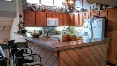 granite top in kitchen - features 3 barstools