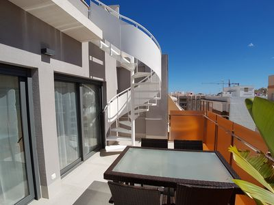 Photo for Modern south facing penthouse close to beach (2min), private rooftop terrace