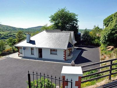 Photo for Detached bungalow in elevated position with large garden, enjoying superb southerly far reachi…