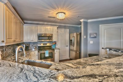 Updated kitchen with granite and stainless appliances.