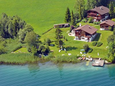 Photo for Romantic chalet directly on the lake