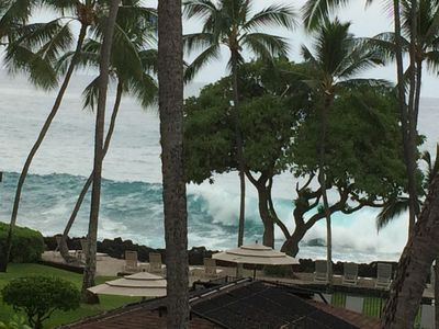 Big surf seen from lanai.  Rocks break the waves so beach is safe.