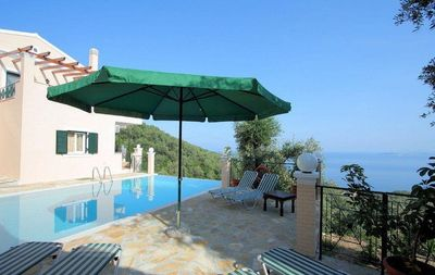 Photo for Villa with private pool, peaceful location, amazing views over Nissaki Bay
