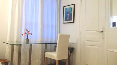 Office table and window with chair and painting