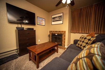 46 inch LCD, fire place, chest of drawers for storage, queen pull out sofa.