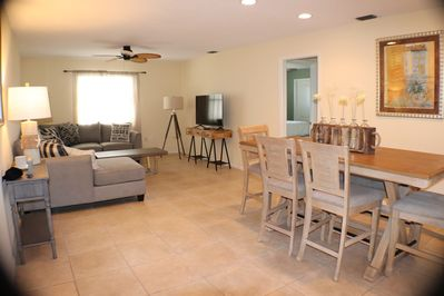 one of two living room and dining areas