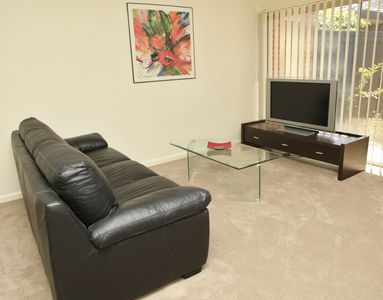"Lounge room with Freedom leather sofa bed and Sony 40"" flat screen tv"