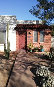 Native cacti dots the xeriscaped front yard