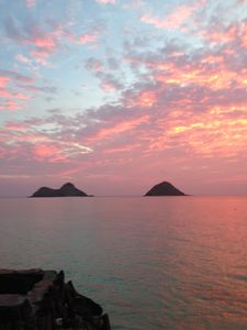 "Lanikai sunrise over the Mokulua Islands as seen from ""the Cove"""