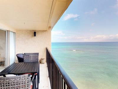 Photo for NEW! Bright oceanfront Hololani condo w/ views, shared pool & beach access